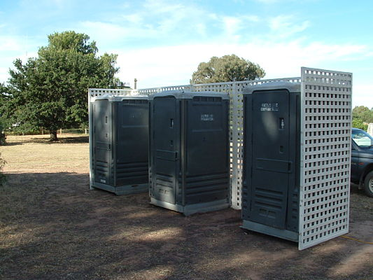 group of 3 toilets